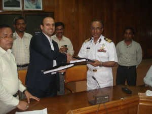 Port Chairman Commodore M. H Bhuiyan & Executive  Director of Timblo Drydocks Mr. Sarvesh Pramod Timblo exchanging files after agreement signing in presence of the Port officials & Operation Director of Western Marine Capt. ABM Fazle Rabbi.