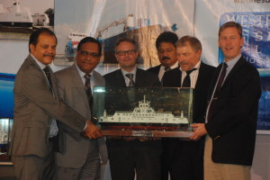The shipyard team handing over a model of ISEFJORD to the owners in presence of the Danish Ambassador