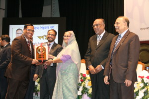 The Managing Director of Western Marine Shipyard, Mr. Sakhawat Hossain receiving Gold trophy from the Hon'ble Prime Minister for contribution in national export for the year 2010-2011.