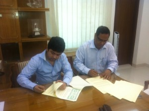 Managing Director Sakhawat Hossain signing agreement with the Managing Director of Neepa Paribahan Mujibur Rahman Chowdhury