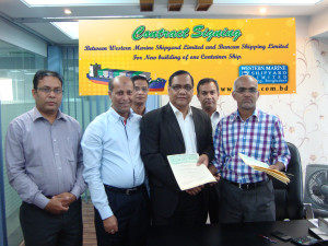 Managing Drector Sakhawat Hossain exchanging files with Managing Director of Bancan Shipping during the contract signing ceremony.