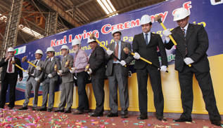 Guests in the Keel Laying Ceremony hammering on the Keel for the Intl. SOLAS Passenger Ship for New Zealand